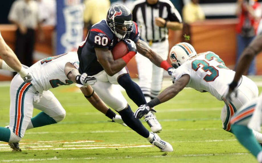 Awaiting the Pro Bowl in his hometown of Miami, Andre Johnson is one of the Texans completing a degree. Photo: Brett Coomer, Houston Chronicle