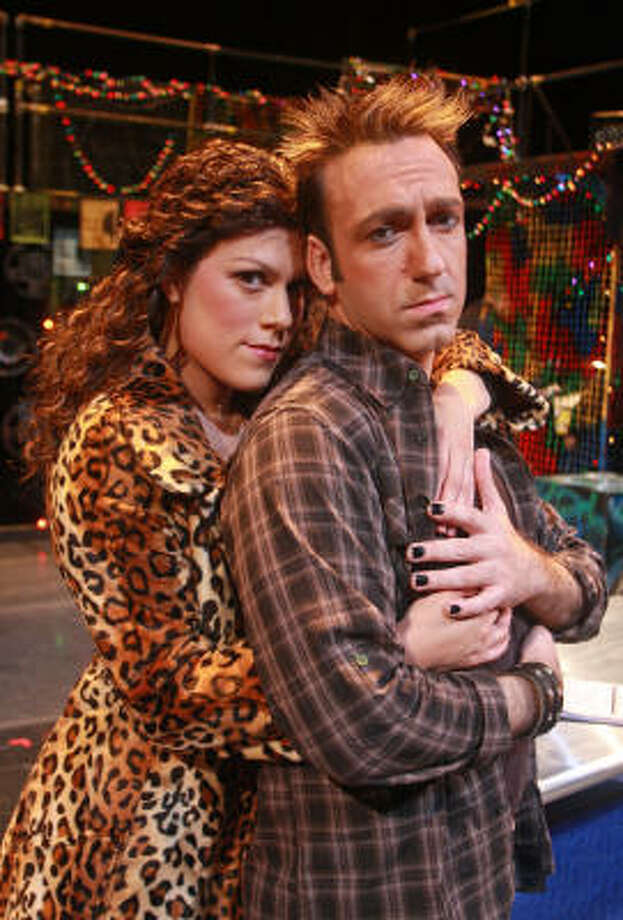 Libby Evans portrays Mimi Marquez and Luther Chakurian stars as Roger Davis in Masquerade Theatre's production of the rock musical Rent. Photo: Gary Fountain :, For The Chronicle