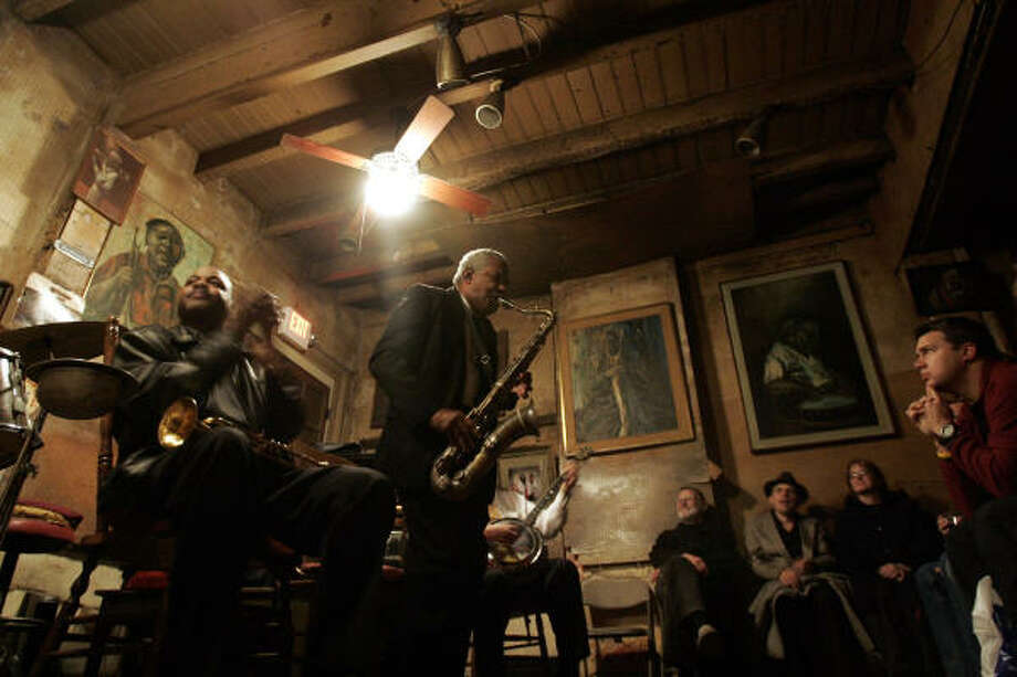 Daniel Farrow plays sax as James Andrews, left, claps his hands during Preservation Hall Jazz Band's performance at Preservation Hall. Photo: CHITOSE SUZUKI, ASSOCIATED PRESS