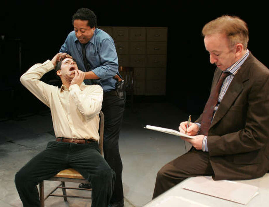 Suspect Katurian (Rick Stear, seated left) gets the treatment from detectives Ariel (David Rainey (standing, left) and Tupolski (John Tyson) in the Alley's 2006 Houston premiere of Martin McDonagh's The Pillowman. Photo: James Nielsen :, For The Chronicle