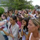 """A crowd gathers to watch from across  the road as Actor Ryan Gosling films on the set of  """"The Place Beyond The Pines"""" filming at the 1st National Bank of Scotia in Niskayuna, NY, on Wednesday, Aug. 3, 2011.( Michael P. Farrell/Times Union)"""