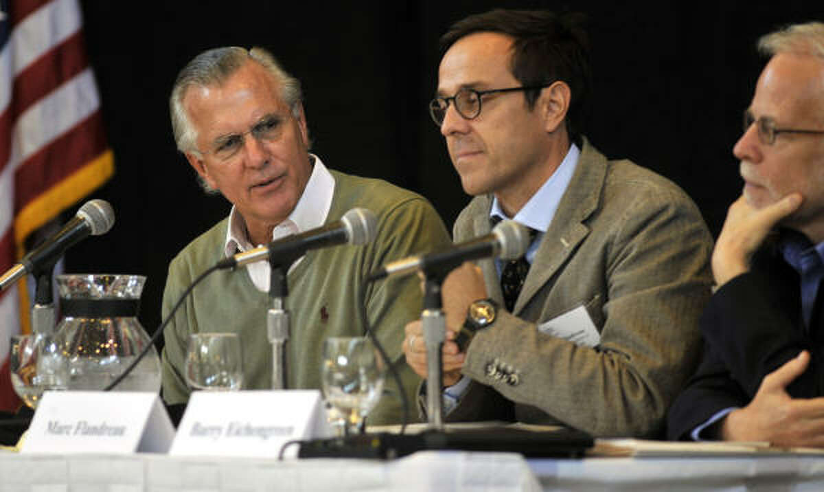 Richard Fisher, president and chief executive officer of the Federal Reserve Bank of Dallas, left, and Marc Flandreau, professor of international history and politics at the Graduate Institute of International and Development Studies, listen during a conference on the history of the Federal Reserve in Jekyll Island, Georgia, U.S., on Friday, Nov. 5, 2010.