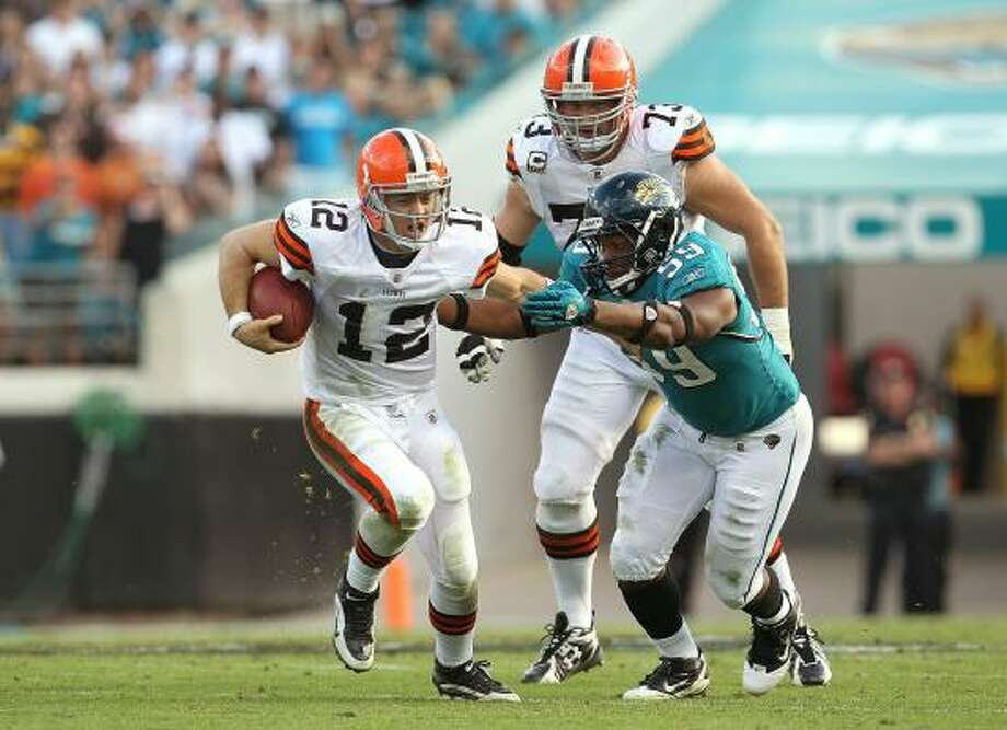 Cleveland Browns quarterback Colt McCoy is chased down by Jacksonville Jaguars defender Larry Hart on Sunday. Photo: Mike Ehrmann, Getty Images