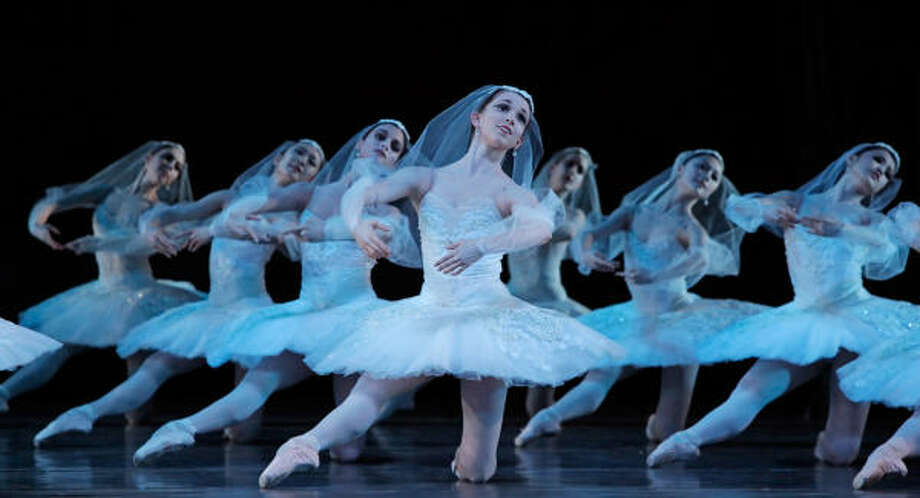 Elise Judson and other artists of Houston Ballet bring the famous Kingdom of the Shades scene vividly to life in the company's new production of La Bayadere, choreographed by Stanton Welch.  Photo: Amitava Sarkar   PLEASE NOTE: Union (American Guild of Musical Artists) regulations require that this photo must be accompanied with the dancers' names. Photo: Amitava Sarkar