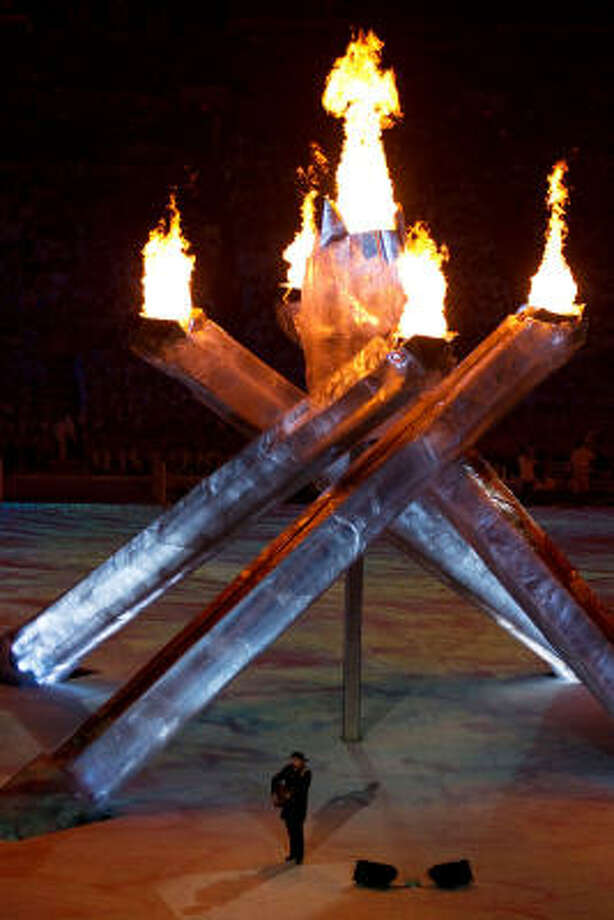Neil Young performs in front of the Olympic torches during the closing ceremony of the 2010 Winter Olympics. Photo: Smiley N. Pool, Chronicle Olympic Bureau