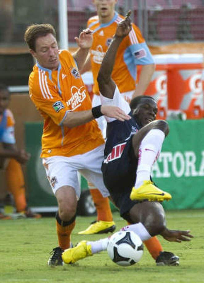 Dynamo midfielder Richard Mulrooney and Pachuca CF forward Franco Arizala fight for possession. Photo: Brett Coomer, Chronicle
