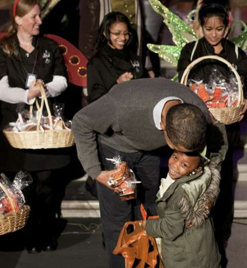 President Barack Obama hugs a trick-or-treater at a White House Halloween celebration on Sunday. Photo: Brendan Smialowski, Getty Images