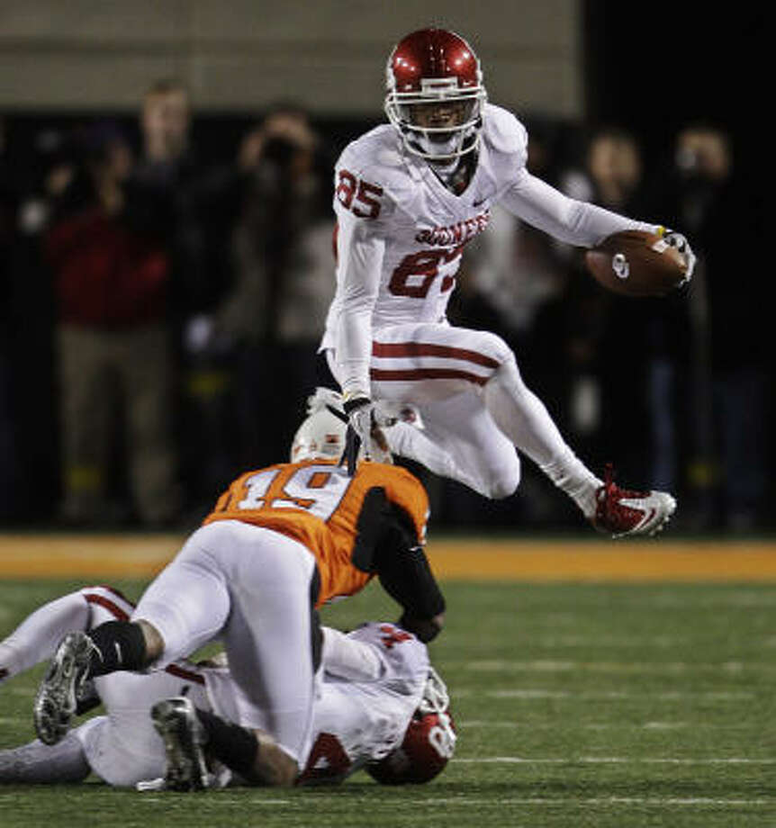 Ryan Broyles and Oklahoma got past Oklahoma State on Saturday, leaving old rival Nebraska as the lone hurdle standing between the Sooners and a BCS berth. Photo: Sue Ogrocki, AP