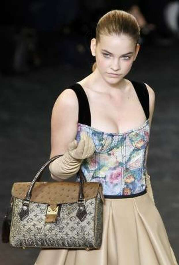 Marc Jacobs' fall collection for Louis Vuitton is heaving with plunging necklines. Photo: FRANCOIS MORI, ASSOCIATED PRESS