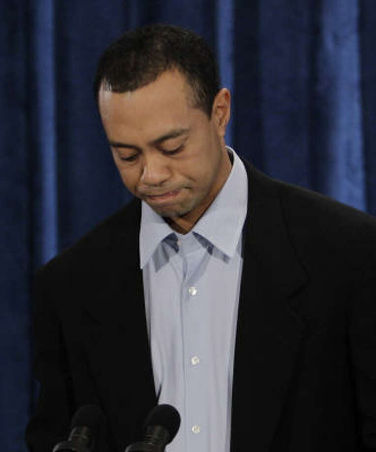 Tiger Woods stressed that his wife never hit him, and there has never been violence in their marriage. Photo: Eric Gay, Associated Press
