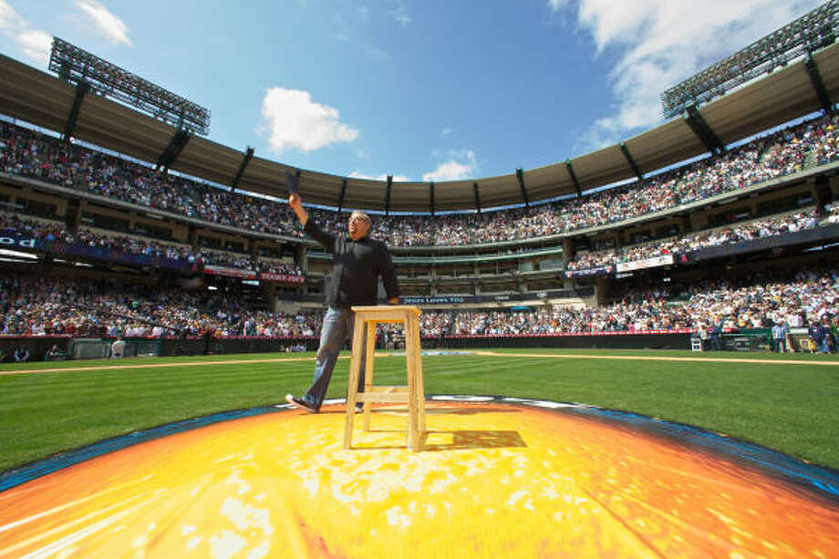 Pastor Rick Warren preaches at Easter services for Saddleback Church at Anaheim Stadium in California. Warren and others have used America's pastime as a way to reach out to the faithful. Photo: SCOTT TOKAR, RELIGION NEWS SERVICE