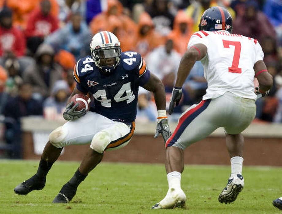 Ben Tate is expected to compete with Steve Slaton and Arian Foster for a starting running back job. Photo: Butch Dill, AP