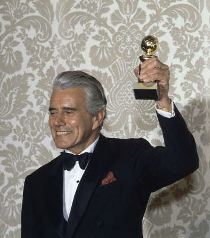 Actor John Forsythe celebrates his Golden Globe for his role in Dynasty in 1983. Photo: Associated Press File