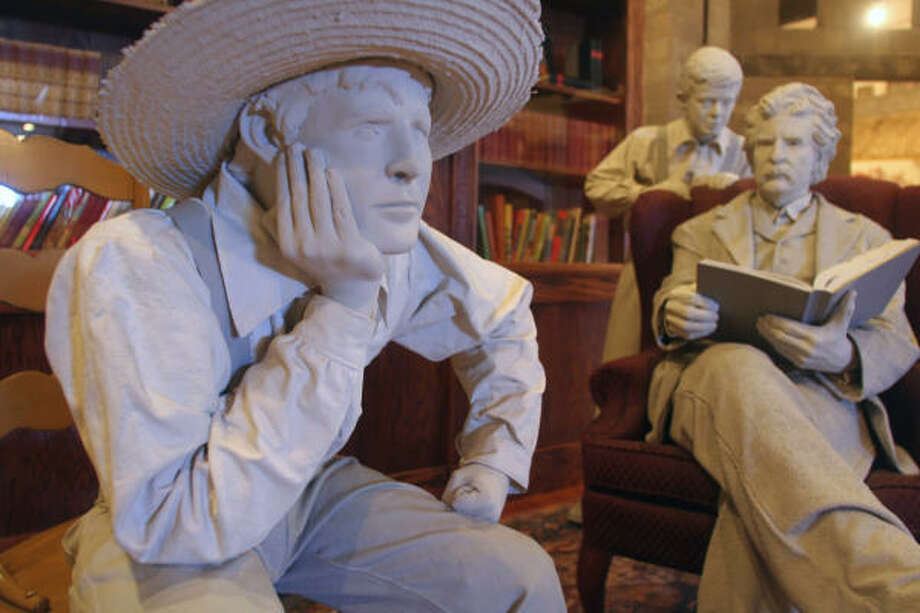 Statues of the author reads and some of his famous characters in the Mark Twain Museum. Photo: TOM UHLENBROCK, St. Louis Post-Dispatch/MCT