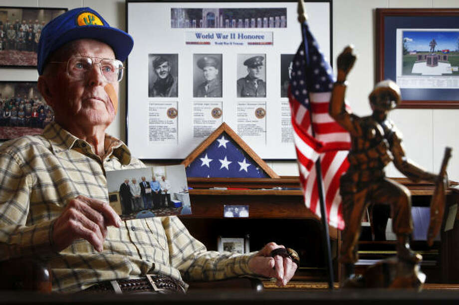 Carl Greene's home in Houston is filled with mementos of the 103rd Division, 409th Infantry, Company K. He and Merle, his wife, maintain the archive for their great-grandchildren. Photo: Michael Paulsen, Chronicle