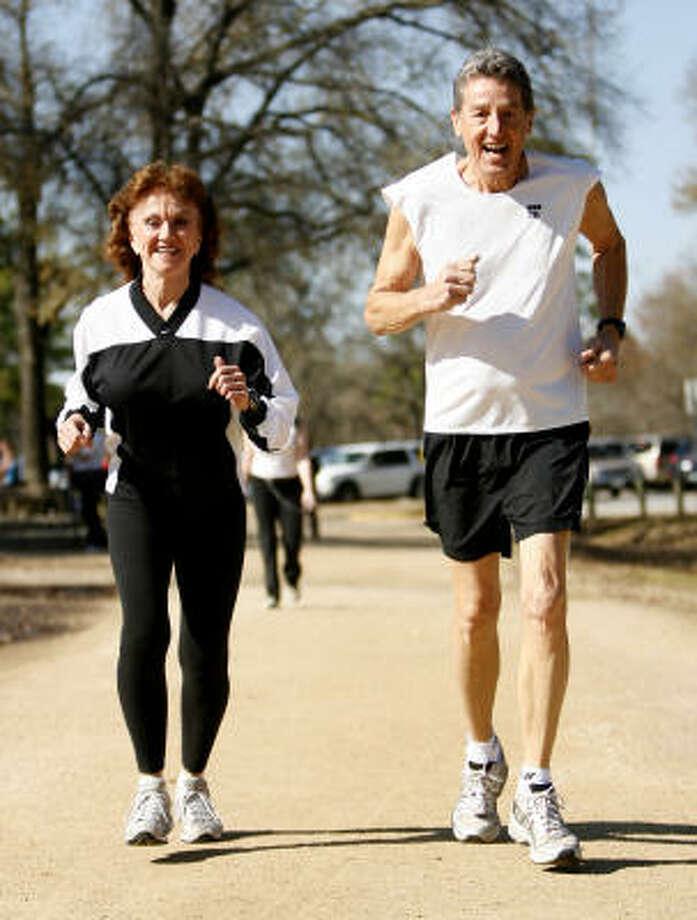 Judy Loy, left, and John Fredrickson, both 71, are ready for Sunday's Chevron Houston Marathon. It will be Fredrickson's 100th marathon since he took up jogging 21 years ago. Photo: Karen Warren, Chronicle