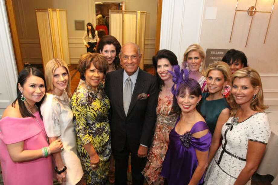 Designer Oscar de la Renta, center, was on hand Wednesday for the Houston Chronicle's 2010 Best Dressed Luncheon and Neiman Marcus Fashion Presentation. He posed backstage with this year's honorees, including, from left: Katherine Le, Greggory Burk, Merele Yarborough, Phoebe Tudor, Kelli Cohen Fein, Danielle Ellis (in foreground), Courtney Hopson, Courtney Hill Fertitta, Eileen Lawal and Susan Plank. The event benefits the March of Dimes. Photo: Bill Olive, For The Chronicle