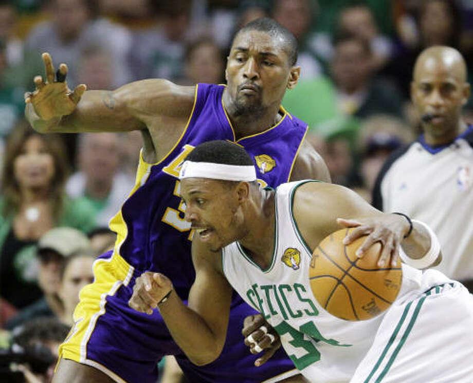 Celtics forward Paul Pierce drives against Lakers forward Ron Artest during Game 5 in Boston. Photo: Michael Dwyer, AP