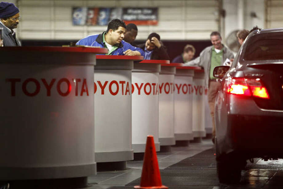 Sterling McCall Toyota employees help customers. Photo: Michael Paulsen :, Chronicle