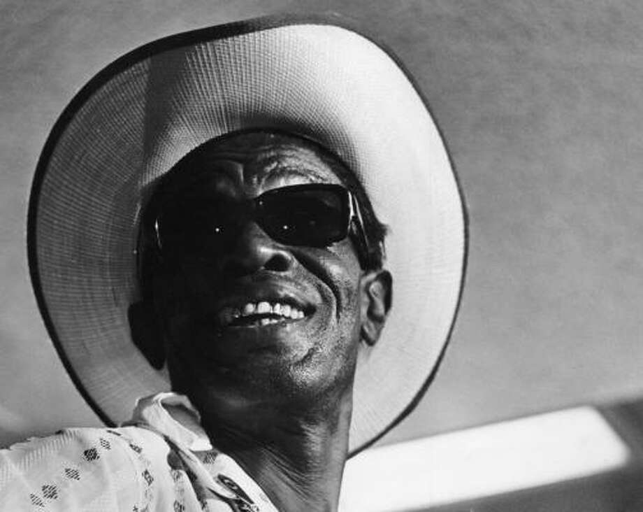 "Blues artist Sam ""Lightnin' "" Hopkins wasn't singing the blues when this photo was taken in 1967. Photo: Chronicle File"