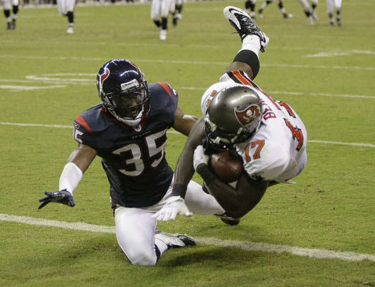 Buccaneers rookie wide receiver Arrelious Benn (17) beats Texans cornerback Jacques Reeves for a 21-yard touchdown reception Thursday at Reliant Stadium.