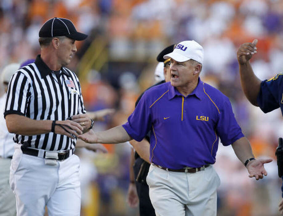 LSU coach Les Miles talks to an official at the conclusion of the Tigers' last second win over Tennessee on Saturday. Photo: Gerald Herbert, AP