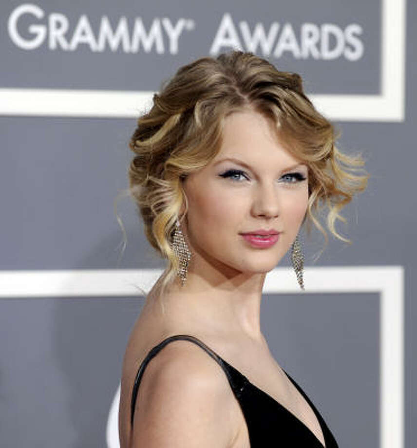 Taylor Swift's Fearless Tour, which includes two sold-out Houston stops, has played to packed arenas around the world. (Yes, world.) It's largely thanks to her innate ability to connect with young fans. Her songs are simple but not simplistic, told in a way that seems unforced and real. Photo: Chris Pizzello :, AP
