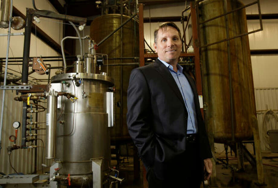 Rich Cilento, Glycos Biotechnologies' chairman and CEO, stands by a fermenter at a company facility in Hempstead. Photo: Melissa Phillip:, Chronicle