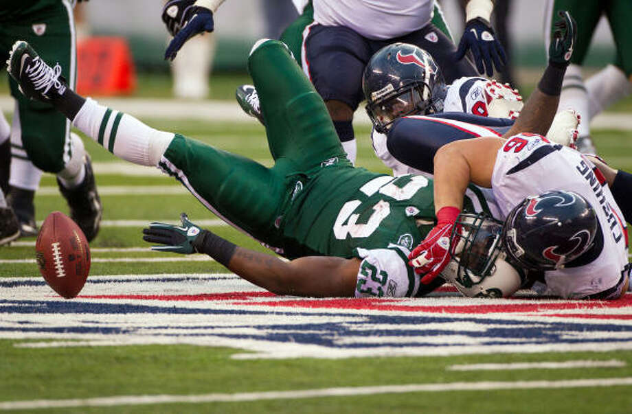 Texans linebacker Brian Cushing (56) forces Jets running back Shonn Greene to fumble in the fourth quarter. The Texans scored immediately after the turnover, but the defense was unable to stop Mark Sanchez and Co. on the game-winning drive. Photo: Smiley N. Pool, Chronicle