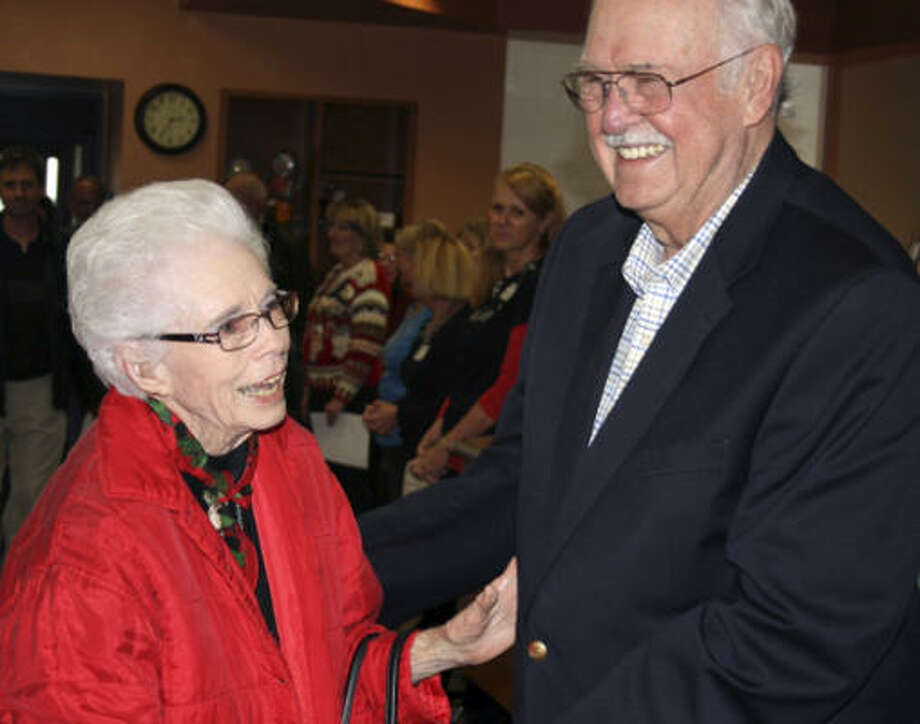 Lucille Rochs, who served on the Hill Country Memorial Hospital Board, is honored by staff members during a recent visit. Greeting her is Jerry Durr, the hospital's first CEO. Photo: Gary Scharrer, Express-News