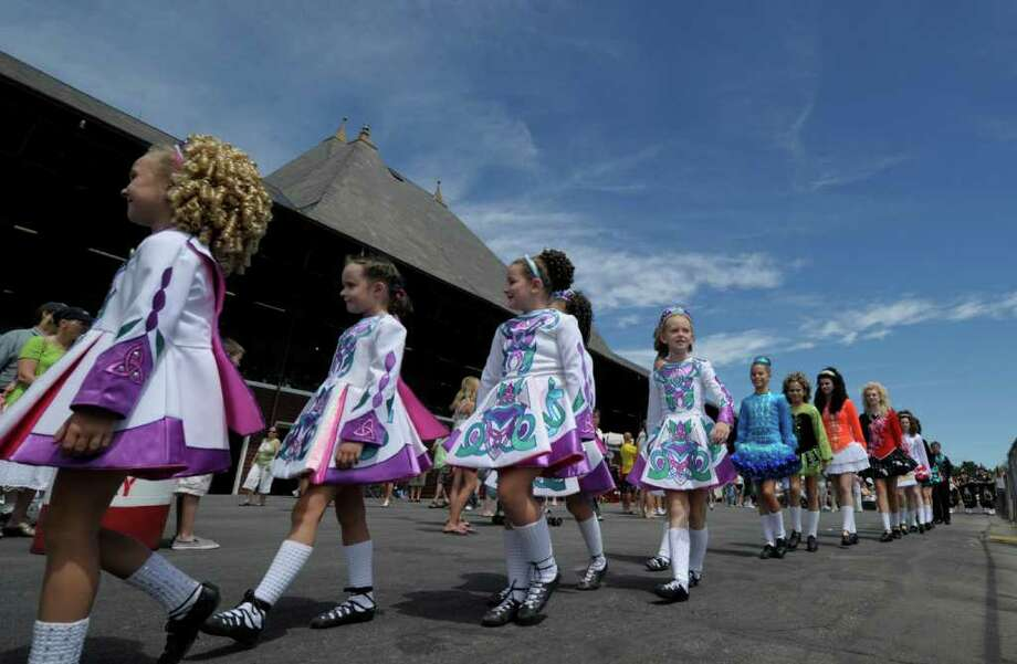 Irish dancers parade for Irish Day at the Saratoga Race Course in Saratoga Springs, N.Y., on Aug. 3, 2011.      (Skip Dickstein / Times Union) Photo: SKIP DICKSTEIN