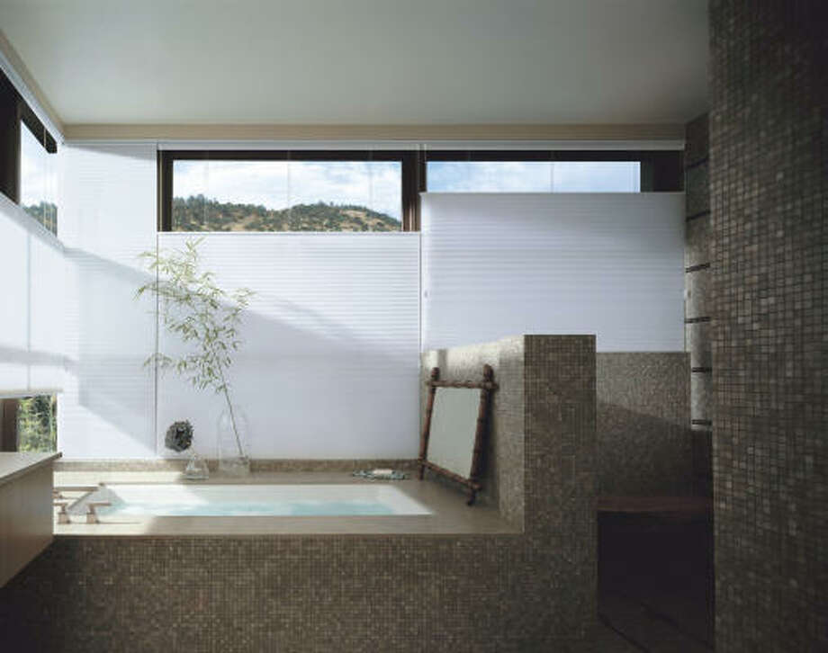 MADE IN THE SHADE: Modesty needn't go out the window with shades that can be adjusted to let light in and keep eyes out.