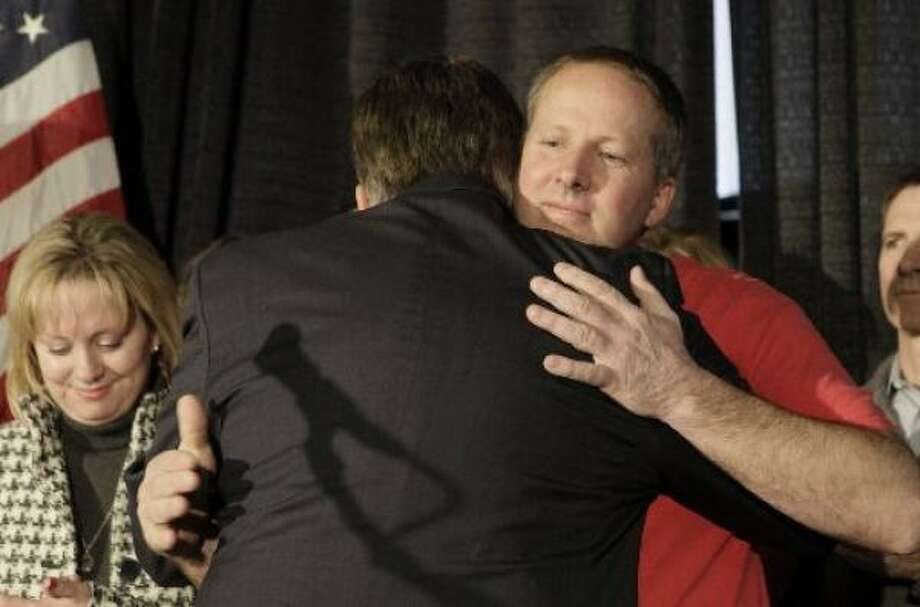 Jim Allen, 47, right, gets a hug after arriving at a welcome- home rally in Amarillo on Thursday. Photo: LM Otero, Associated Press