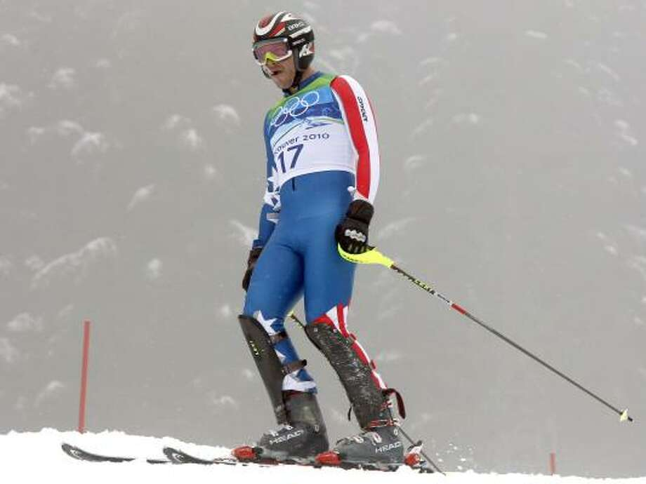 Bode Miller reacts after skiing out of the first run of the men's slalom. Photo: Luca Bruno, AP