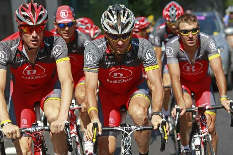 Lance Armstrong, center, says he's staying to help his teammates – Radio Shack's new leader is Levi Leipheimer - enjoy their company and soak up the pageantry of the Tour. Photo: Bas Czerwinski, AP