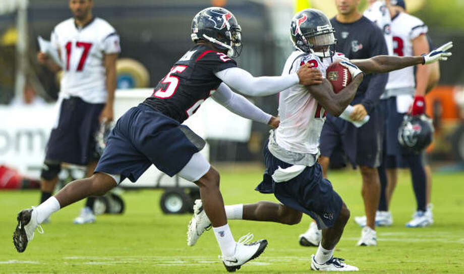 Texans rookie cornerback Kareem Jackson, left, will miss Saturday's preseason opener against Arizona due to a death in his family. Photo: Brett Coomer, Chronicle