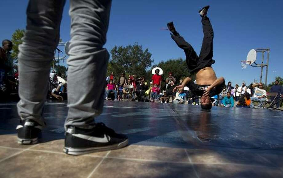 Break dancer Rudy Rodriguez, 27, with the group Youth Advocates, performs Saturday during the hip-hop-based environmental justice festival Life is Living at Emancipation Park in Houston. Photo: Johnny Hanson, Chronicle