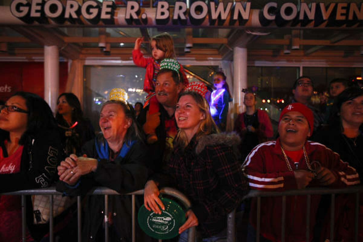 A crowd admires art cars at the Gloworama New Year's Eve bash, held at Discovery Green and the George R. Brown Convention Center.