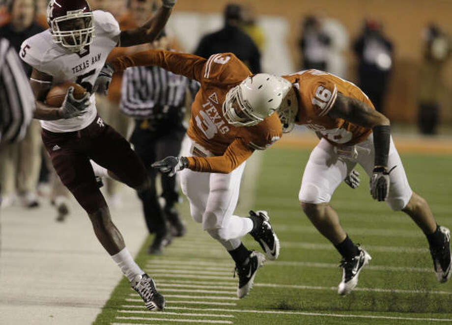 Texas cornerback Curtis Brown shoves Texas A&M wide receiver Kenric McNeal out of bounds. Photo: Karen Warren, Chronicle