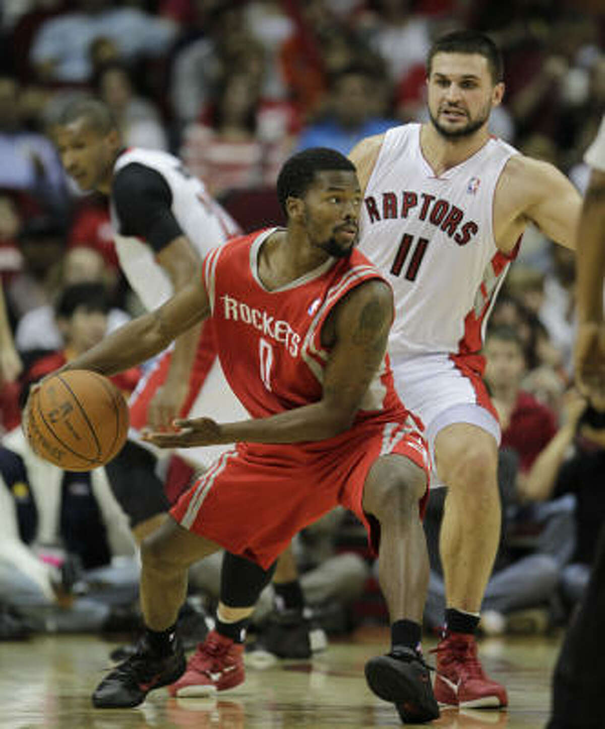 Dec. 31: Rockets 114, Raptors 105 Rockets guard Aaron Brooks (0) tries to pass against the defense of Toronto's Linas Kleiza during the first half of Friday's game at Toyota Center.