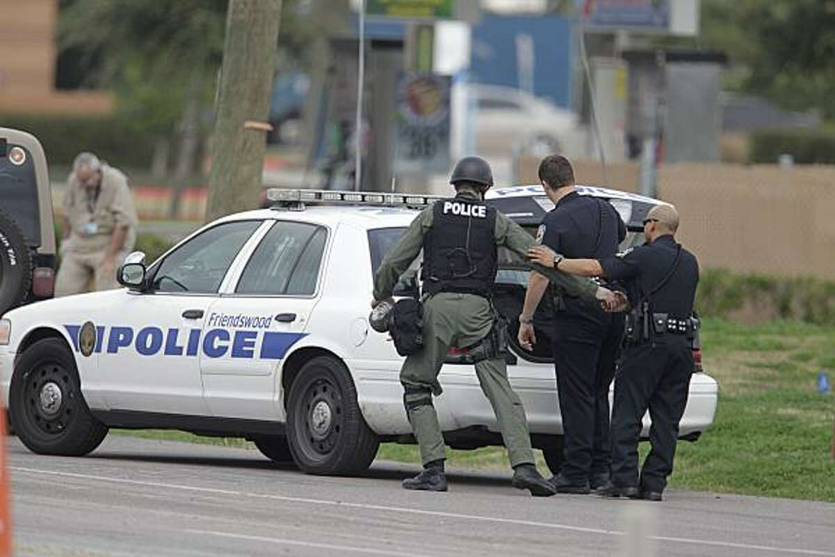 Police at the scene of a bank robbery in Pearland, TX.