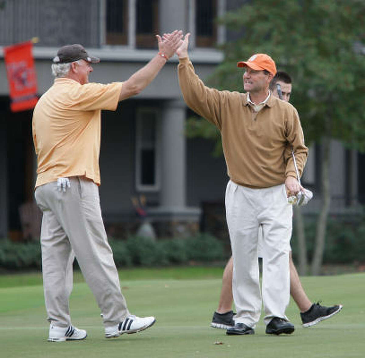 Thomas Ross, right, celebrates with his partner, Jerry Wilson, after making a putt on the seventh hole.