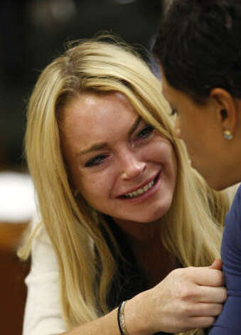 "Remember when: A highly-troubled Lindsay Lohan let her finger(nails) do the talking. Her message, ""*Expletive* You"", was the manicure read 'round the world. Photo: David McNew, AP"