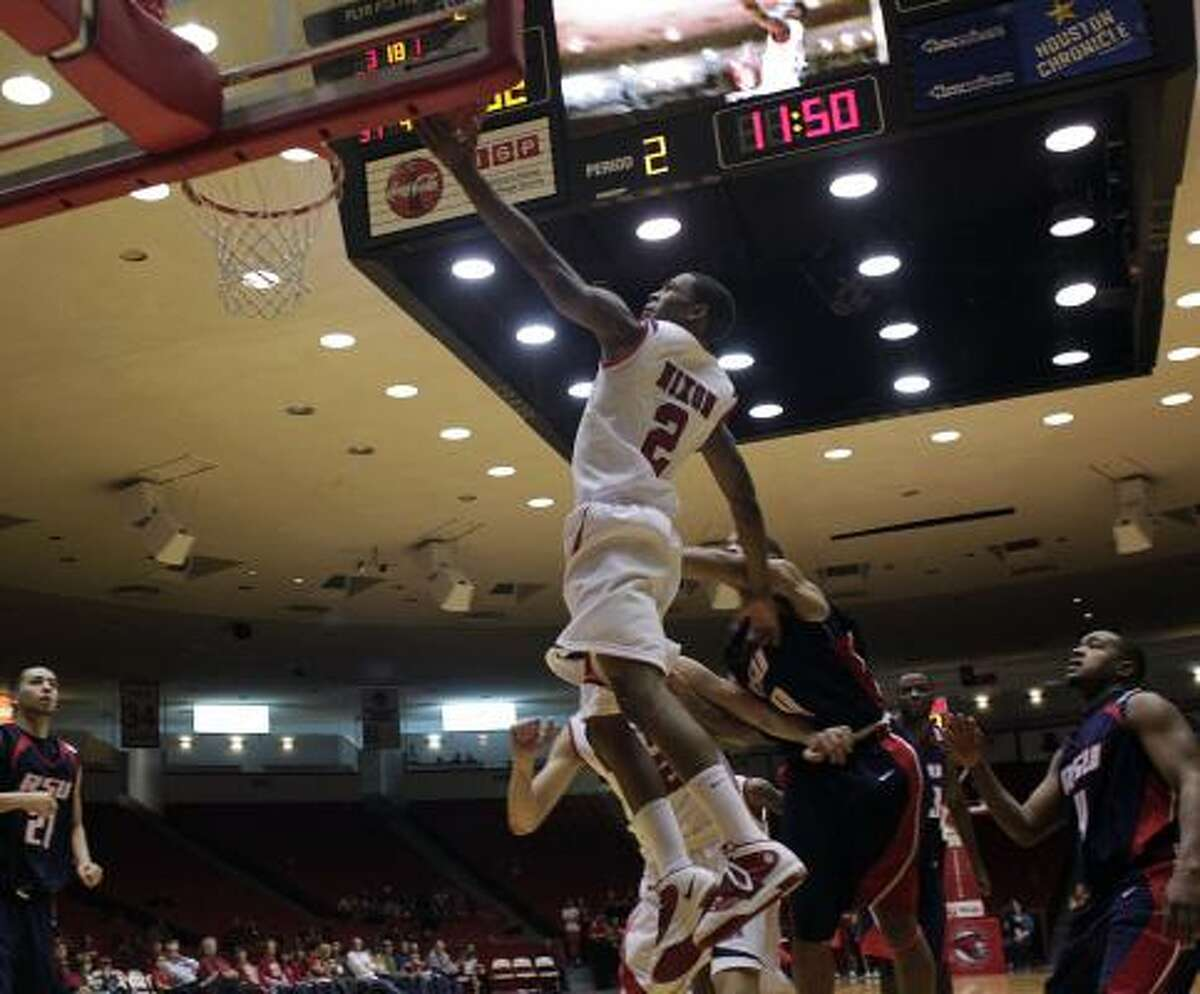Dec. 30: UH 85, Rogers State 48 UH guard Zamal Nixon drives to the basket in the second half of Wednesday night's game against Rogers State at Hofheinz Pavilion.