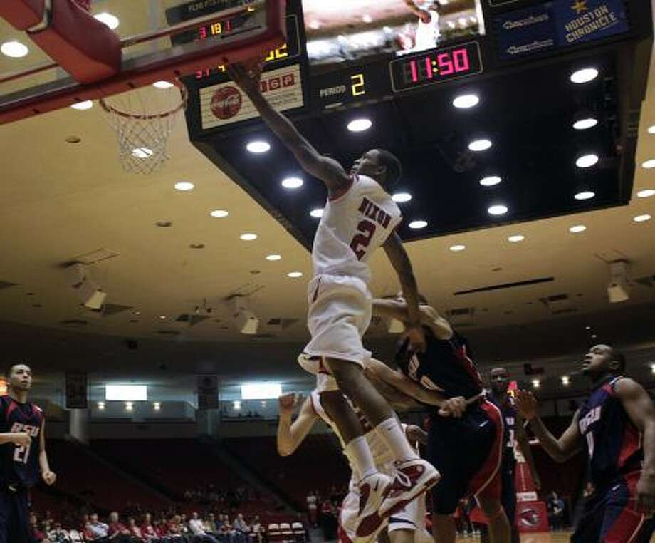 Dec. 30: UH 85, Rogers State 48UH guard Zamal Nixon drives to the basket in the second half of Wednesday night's game against Rogers State at Hofheinz Pavilion. Photo: Johnny Hanson, Chronicle