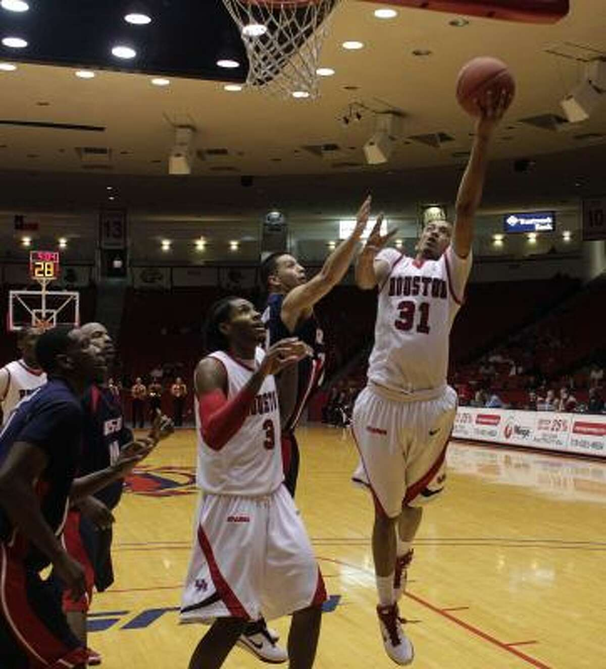 UH guard Adam Brown (31) drives to the basket in the second half. He finished with 13 points.