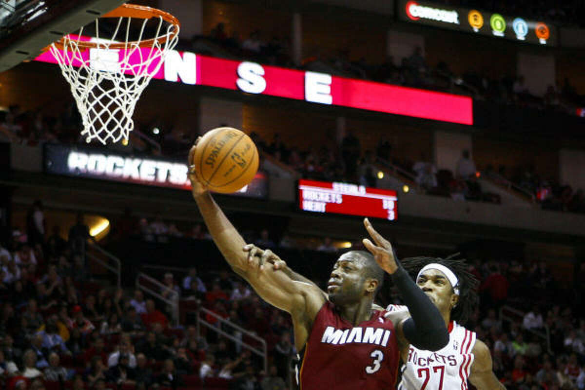 Dec. 29: Heat 125, Rockets 119 Heat guard Dwyane Wade (3) torched the Rockets' defense for a season-high 45 points on 17-of-24 shooting to propel Miami to its fourth straight win and 16th in 17 games.