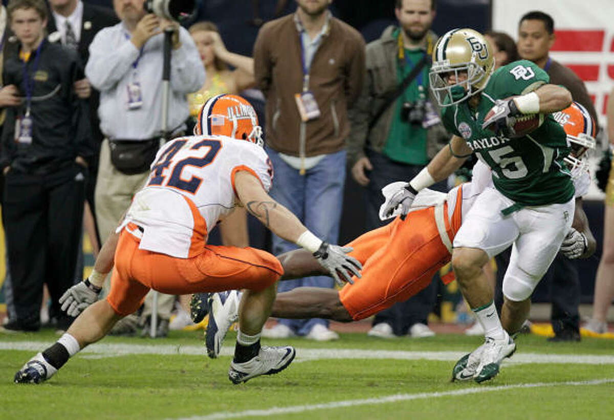 Dec. 29: Illinois 38, Baylor 14 Baylor's Krys Buerck, right, attempts to out-run Illinois' Aaron Gress (42) during Wednesday's Texas Bowl at Reliant Stadium.