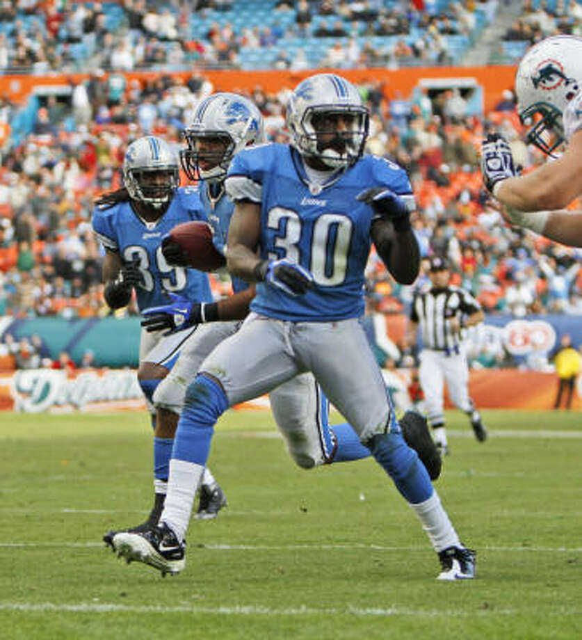 Lions 34, Dolphins 27 Lions linebacker DeAndre Levy (w/ball) returned an interception 30 yards for the go-ahead touchdown with 2:11 left in the fourth quarter. Photo: J Pat Carter, AP
