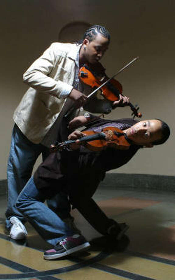 Brothers Damien and Tourie Escobar are Nuttin' But Stringz. The duo plays hip-hop and classic violins. Photo: Nuttin' But Stringz